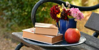 Books, apple, flowers, bench